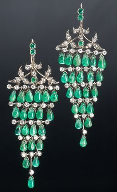 Indian emerald and diamond earrings for the English colonial market, ca. 1920. Designed as bunches of grapes in silver-topped gold, with articulate tiers of teardrop-shaped emeralds and diamonds, below diamond-set leaves. Diamonds: approx. 3 cts. TW.