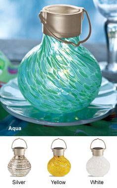 Handblown Solar Glass Lantern - No cords or batteries to worry about with these finely crafted handblown glass solar lights. The soft-glowing LED hidden inside even goes on automatically at dark. Place on a table or hang on a hook.
