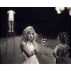 I remember seeing this photograph at NOMA in 1990 - my mom took me there after my kindergarten graduation. I remember being completely perplexed by this young girl with a cigarette - it's still as intriguing now as it was then