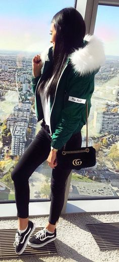trendy fall outfit idea green bomber   bag   black skinnies   sneakers