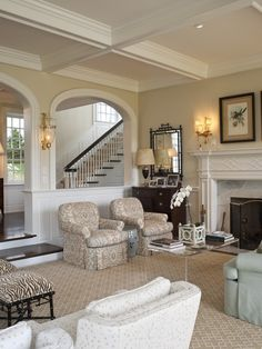 Houzz...like the step down parlor and arches, millwork