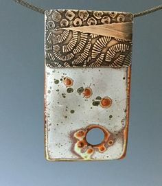 enamel piece, originally fired with white liquid enamel, then torched with acetyline torch to discolor.