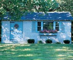 "10' x 20' Building - As a small guest house, this building sits attractively in your yard. Shingled front with Board and Batten on ends and back. Complete with 4' wide solid door, 20 lite picture window with 2 side sashes, louvered shutters and 60"" flower box. Special body stain and trim."