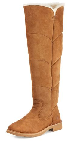 """Sibley Shearling Over-the-Knee Boot by Ugg. UGG boot in twin-face sheepskin and cow suede. Dyed lamb shearling (Australia, UK, USA, or Ireland) fur lining. UGGpure 100% wool insole. 1"""" flat heel. Round toe. Notched sides. Side zip eases dress. Rubber outsole. """"Sibley"""" is imported. #ugg #shoes #boots"""