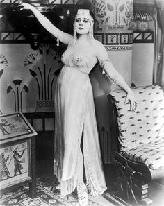 Silent Movie actress Theda Bara in some of her famously risqué costumes from the 1917 film Cleopatra.