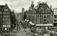 1946. A view of Damrak in Amsterdam. On the right department store De Bijenkorf. In the center tram line 24 with the windows boarded up with plywood due to lack of glass shortly after the liberation of German occupation. Photo Jeroen Epema. #amsterdam #1946 #Damrak
