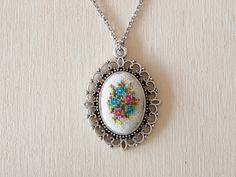 Hey, I found this really awesome Etsy listing at https://www.etsy.com/listing/207357886/cross-stitch-pendant-blue-and-pink