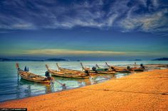 Boats from a local fishing village at Ao Po Marina, Phuket, Thailand.