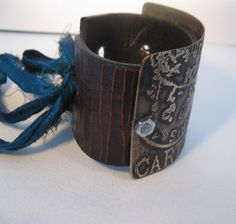 etched metal recycled leather cuff by mollyheltsleydesigns on etsy.com, $28.00