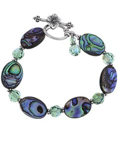 @Overstock - This unique sterling-silver bracelet features alternating aqua Swarovski crystals and ovular paua shell beads, which have a natural blue-green opalescence that is truly stunning. This bracelet has a toggle clasp and makes a thoughtful gift.http://www.overstock.com/Jewelry-Watches/Charming-Life-Sterling-Silver-Paua-Shell-and-Crystal-Bracelet/2558292/product.html?CID=214117 $42.74