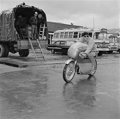 This familiar face in an unfamiliar setting is Hollywood actor Steve McQueen as he attempts to beat Hong Kong rush hour by riding home on his streamlined Japanese motorcycle. McQueen is in Hong Kong for the filming of Sand Pebbles, on location here and in Taiwan.