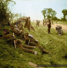 No.4 Company, 1st.Welsh Guards, in action near Cagny, Caen, Normandy during 'Operation Goodwood', 19th of July 1944. The Company Commander, Maj J. D. A. Syrett, is seen indicating a mortar target to Sgt Vessey. Gdsm Kitchen is in the foreground and Gdsm Fenwick is the Bren gunner. Major Syrett was killed a few days later...