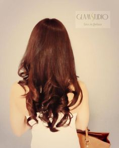 Dark auburn hair color.