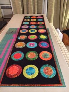 Black table runner with Batik Circles by QuiltsByNancyGilmore