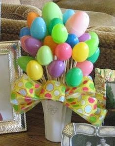 Use colorful plastic eggs to craft this cute table top display for your Easter extravaganza.