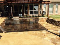 Cedar arbor and Oklahoma stone kitchen with Oklahoma flagstone patio