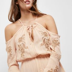 Checkout this Pink floral embroidered cold shoulder top from River Island