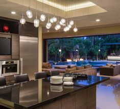 This contemporary kitchen with an amazing outdoor connection was completed by @cooperpacific. #luxeLA
