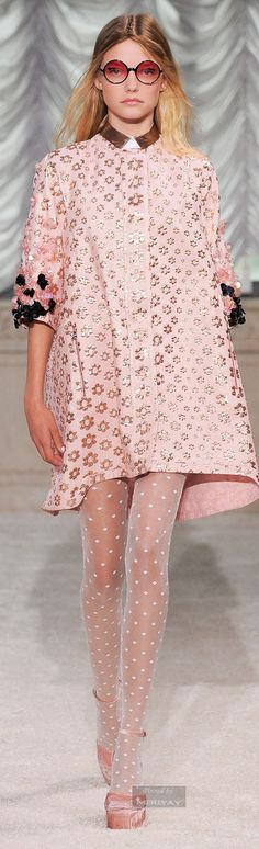 Giamba.Spring 2015. The trapeze silhouette, which this design features, was an alternative silhouette to the New Look in the 1950s. The dress flares out from the shoulders and is unfitting, differing greatly from the standard shape. The trapeze silhouette would remain popular through the 1960s. 4.7.15