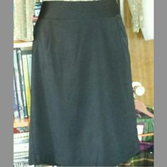 Classic straight skirt, banded waist, kick pleat Basic black above-knee business casual skirt. Completely versatile wardrobe essential, perfect for the office, then drinks and dinner. Pair with a fabulous sweater or elegant blouse. Back zip, and two loops for a wide belt. Good used condition, practically indestructible. (See 2nd pic for truest color) Pantology Skirts Pencil