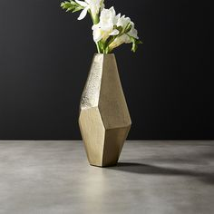 Shop Von Gold Geomtric Vase.   Carved planes give geometric vase angled form.  Made by craftsmen that pour melted aluminum into a mold, then use hand tools to finish the piece with a rough, textured polish.  CB2 exclusive.