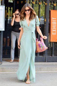 8b286fad77 Simple wrap dress + colourful bag + jeweled sandals. Miranda Kerr Street  Style