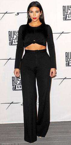 Cream of the crop: Kim Kardashian showed off her toned midriff in a black crop top and trousers for gala dinner at Toko Dubai Restaurant in Dubai, UAE