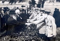 1913 | Tumblr Union and Confederate veterans shake hands at Gettysburg in 1913.  I don't know - they still look kinda pissed to  me. :)