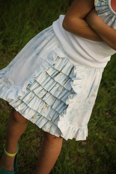 """This skirt has been on my to-do (again) list for months. I made an initial version of the layered ruffles skirt as a dress (the """"light and breezy dress"""") for Olivia's birthday last fall. I do like how it turned out in skirt version this time. To make this style, you are going to make...Read More »"""