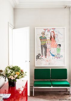 Ramdane and Victoire's Paris Apartment, Eiffel Tower, 7th arrondissement, wall art, green couch / Garance Doré