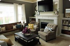 Eclectic living room with contemporary classic furnishings along with a church pew via Jones Design Co