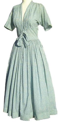 So pretty and feminine is this vintage mid 40's Claire McCardell day dress with teal blue beet print and flowing skirt, which is identical to a