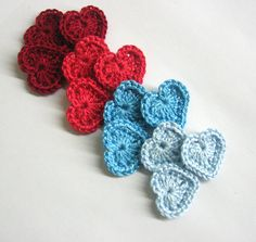 Red and blue crochet heart appliques