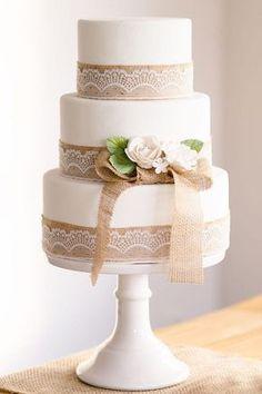 rusticwhite wedding cake with burlap lace details / http://www.deerpearlflowers.com/rustic-country-burlap-wedding-cakes/