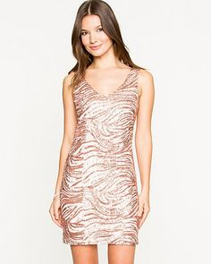 Remain poised and polished clad in this glam sequin tunic.