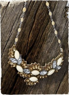 Light up the night with opulent statement pieces of glass crystal mixed with snow-white enamel on kidskin.