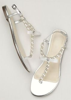 Elegant yet understated, thesepearl and crystal t-strap sandals are perfect for any event!  Blue by Betsey Johnson t-strap sandals feature a mix of opulent pearls and glistening crystals that will instantlyadd glamour toyour look.  Available in sizes 6-10.  Imported.