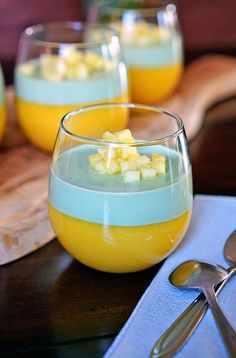 Tropical Mango Matcha Panna Cotta - The subtle, tasty matcha green tea works beautifully on the palate and the tangy, creamy mango offsets it nicely. Topped with diced pineapple and this makes one delicious and elegant dessert.