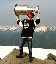 Willie Mitchell at the top of the world with the Stanley Cup!! Such an awesome picture!!