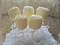 Marshmallows covered in white choc, part of table centre pieces!