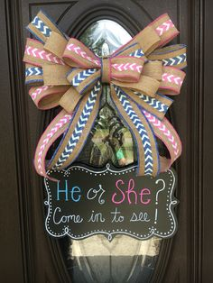 Door bow and chalkboard for gender reveal.                                                                                                                                                                                 More
