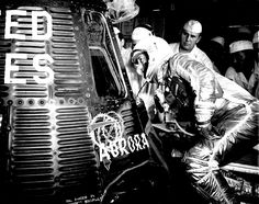Cape Canaveral, Fla.: Astronaut Scott Carpenter looks inside Aurora 7 spacecraft prior to insertion. McDonneld and NASA capsule technicians along with Astronauts Wall Schirra and John Glenn watch Carpenter prepare for his programmed three-orbit mission.