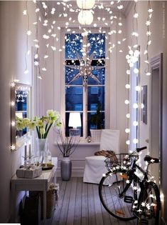 Examples of how to use fairy lights in your home around the mirror, window frame, ceiling and even bike! Fun for parties