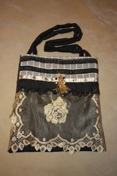 Handmade, shabby chic handbag made with upcycled fabrics, doilies, lace, ribbon and vintage tassel and jewellery. on Etsy, $48.07 CAD