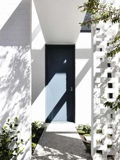 Perforated Brick Entrance Screen Defining Fairbairn Road House in Australia - http://freshome.com/2014/08/28/perforated-brick-entrance-screen-defining-fairbairn-road-house-in-australia/