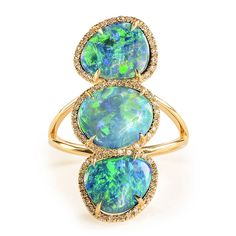 Our triple opal and diamond ring captures brilliant color and sparkle.  It's also October's birthstone.