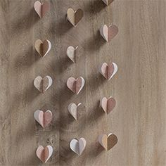 Learn how to make a paper heart garland perfect for a valentine's day party or wedding!