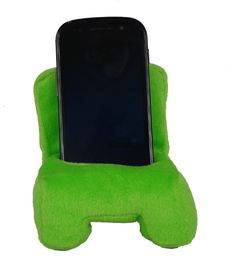 This soft mobile phone chair is a perfect accompaniment to any mobile phone. Looks great on any office desk or bedside table. Can fit phones with a width of up to 6cm.  Available in 5 different colours.
