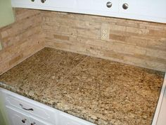New Venetian Gold Tile Countertop With Mosaic Travertine Tile Backsplash  And Matching Hand Painted Outlet Cover Plates.