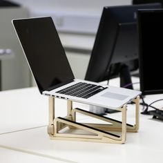 Wooden laptop stand. CNC precision cut and hand finished in the UK from sustainable source plywood. Makes a perfect MacBook riser and has a built-in tablet stand that can be used separately for drawing on your iPad Pro. Improve your home office ergonomics. Available from helmm.co for £45 with free shipping. There is currently a 10% offer on too for a limited time.